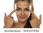 young woman applied concealer... | Shutterstock . vector #549197950