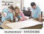 family unpacking cardboard... | Shutterstock . vector #549204388