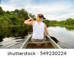 blonde girl riding canoe in... | Shutterstock . vector #549230224