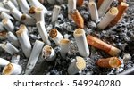 a cigarette on an ashtray with... | Shutterstock . vector #549240280