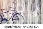 vintage bicycle parked beside...   Shutterstock . vector #549251164
