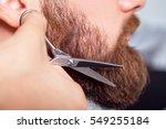 barber with scissors shaving