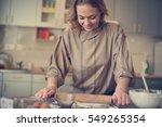 Portrait Of Woman In Kitchen...