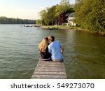 Young Couple Sitting At End Of...