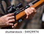 A man holding a dart gun - stock photo
