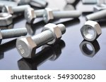 background from bolts and nuts | Shutterstock . vector #549300280