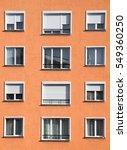 Small photo of Exterior of modern light orange or ocher urban housing block with apartments