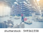 boxes in blurred warehouse... | Shutterstock . vector #549361558
