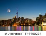 a rising moon over toronto ... | Shutterstock . vector #549400234
