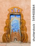 Small photo of Santa Fe, USA - July 30, 2015: Door to San Miguel Mission chapel church, the oldest in the United States, decorated in adobe pueblan style