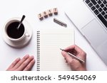 top view of hand writing on a... | Shutterstock . vector #549454069