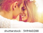 Stock photo summer holidays love romance and people concept happy smiling young hippie couple hugging 549460288