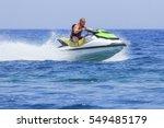 having fun on jet ski | Shutterstock . vector #549485179