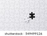 white jigsaw puzzle | Shutterstock . vector #549499126