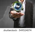 globe  earth in human hand ... | Shutterstock . vector #549524074