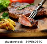 grilled juicy steak with... | Shutterstock . vector #549560590