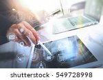 designer businessman hand using ... | Shutterstock . vector #549728998