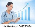 Surgeon Using Digital Tablet...