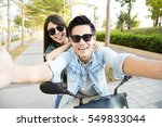 happy young couple riding ... | Shutterstock . vector #549833044