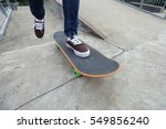 young skateboarder legs riding... | Shutterstock . vector #549856240
