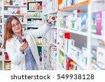 woman pharmacist holding... | Shutterstock . vector #549938128