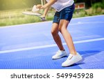 Asian Girl Holding Badminton...