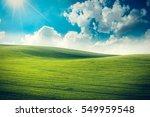 green sunny valley landscape | Shutterstock . vector #549959548