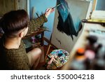 Small photo of Male Artist Working On Painting In Bright Daylight Studio