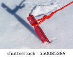 red tent peg hammered in a snow ... | Shutterstock . vector #550085389