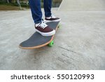 young skateboarder legs riding... | Shutterstock . vector #550120993