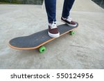 young skateboarder legs riding... | Shutterstock . vector #550124956