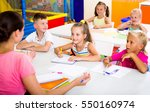 beautiful kids sitting and... | Shutterstock . vector #550160974