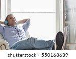 full length of relaxed middle... | Shutterstock . vector #550168639