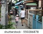 a mother and her child are... | Shutterstock . vector #550286878