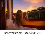 young woman enjoys sunset... | Shutterstock . vector #550288198