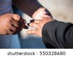 bride and groom exchanging... | Shutterstock . vector #550328680