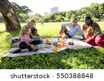 family picnic outdoors... | Shutterstock . vector #550388848