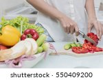 young happy woman cutting... | Shutterstock . vector #550409200