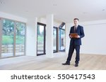 Small photo of Estate Agent Looking Around Vacant Property For Valuation