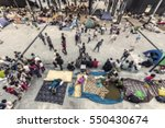 blurred migrant people in the... | Shutterstock . vector #550430674