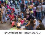 blurred migrant people in the... | Shutterstock . vector #550430710