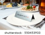 reserved plate on a table in a... | Shutterstock . vector #550453933