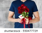 Stock photo a man with red roses and valentine in the hands valentine day love beautiful 550477729