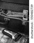 razor and a suitcase with jeans | Shutterstock . vector #550482739