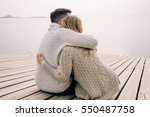 couple hugging on a pier | Shutterstock . vector #550487758