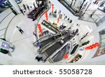 People make shopping in big modern mall. Crowd in motion blur - stock photo