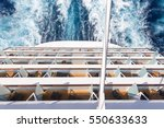 Balconies on a back of Cruise ship, decks with wake or trail on ocean surface - stock photo