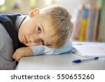 portrait of a tired student... | Shutterstock . vector #550655260