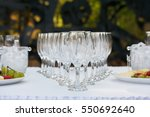many glasses of champagne on... | Shutterstock . vector #550692640
