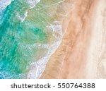 aerial view of a sandy beach | Shutterstock . vector #550764388